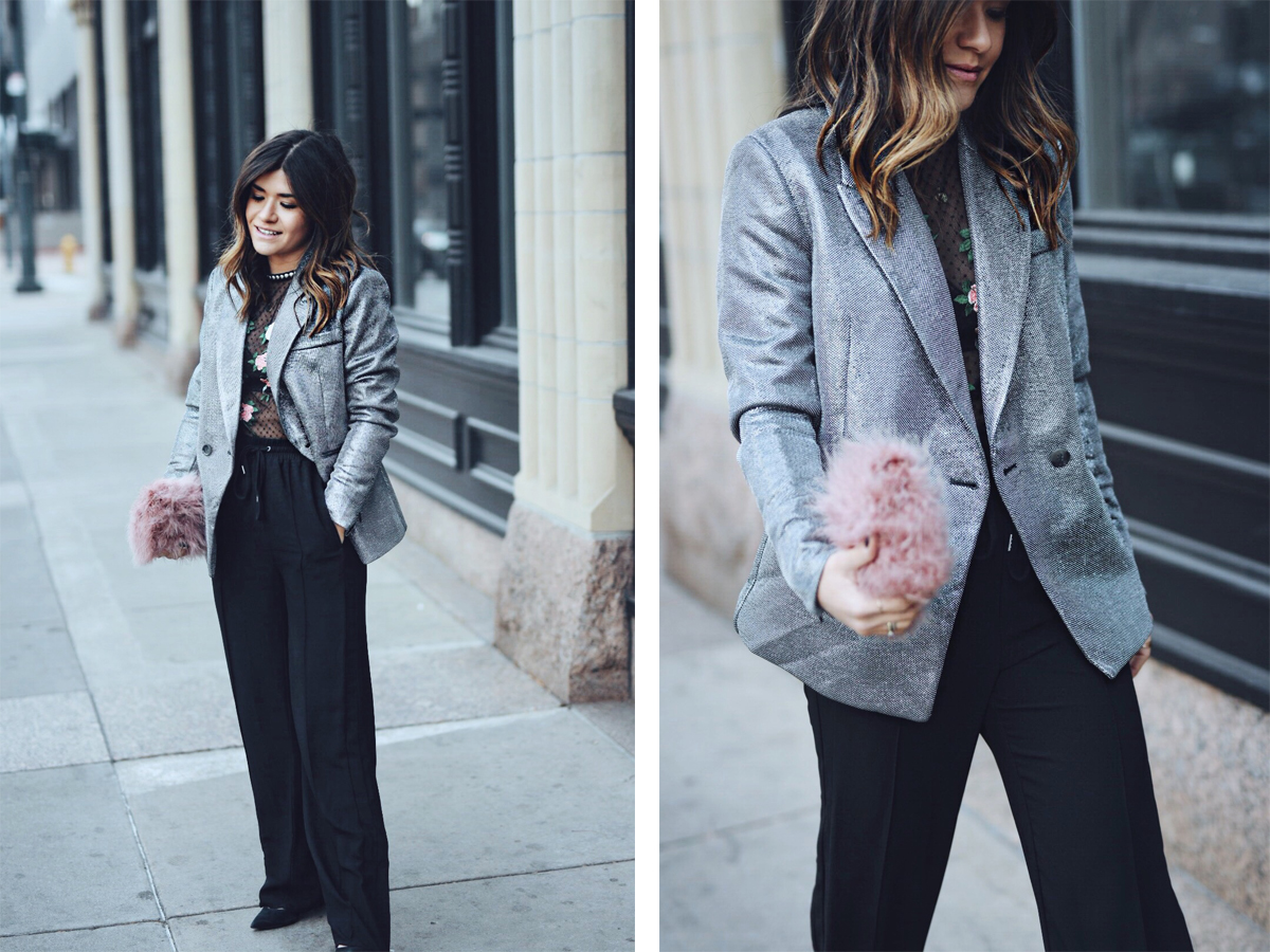 Carolina Hellal of CHIC TALK wearing an H&M silver blazer, black track pants, Topshop lace top and feather bag