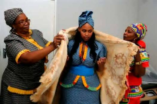 A pretty African Bride in Traditional African Dress Being Received in New Home