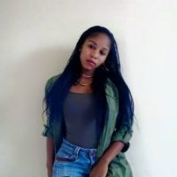 Pretty South African Babe in Long Dreads and Ripped Jeans
