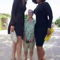 Elegant Tall Black Women Standing with Average Man