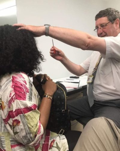 Mercy Aigbe being examined by a face surgeon in London