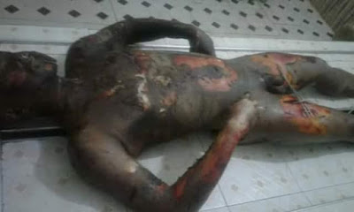 Graphic photos: Military officer 'mistaken' for armed robber lynched and burnt to death by mob in Ghana