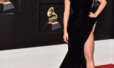 Leggy Rita Ora suffers a wardrobe mishap in a VERY daring velvet gown at GRAMMYS awards