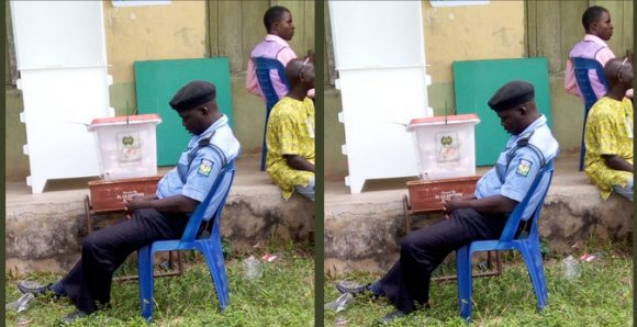 Hilarious Photo shows how policeman watch ballot box fell asleep in Ekiti state