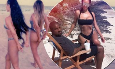 Skinny Kim Kardashian's ribs are visible as she sits on miserable-looking husband Kanye West on sun-soaked holiday