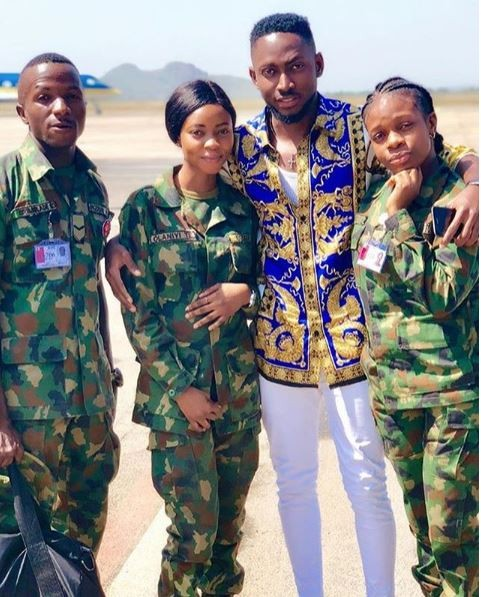 BBNaija 2018 Winner, Miracle poses with two female soldiers