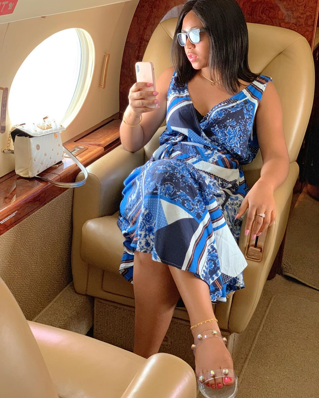 Regina Daniels show off engagement ring in a private jet