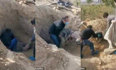 Watch as Paralyzed old woman pulled from grave alive three days after son buried her