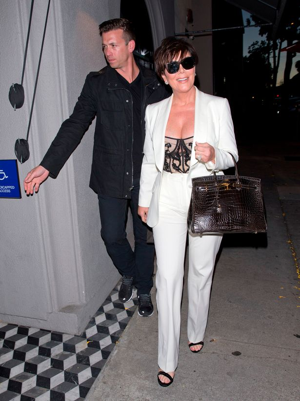 Kris-Jenner-wearing-an-All-White-outfit-and-sunglasses-was-seen-arriving-at-Craigs-Restaurant-in-Wes