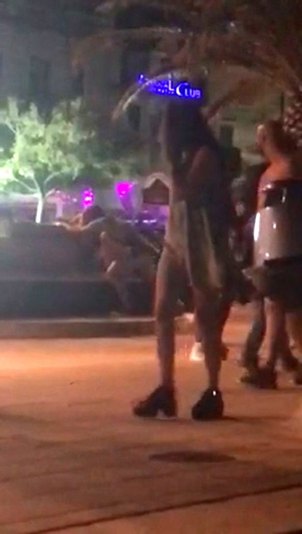 Shocking moment shameless couple are caught having s*x on a bench in front of shocked onlookers