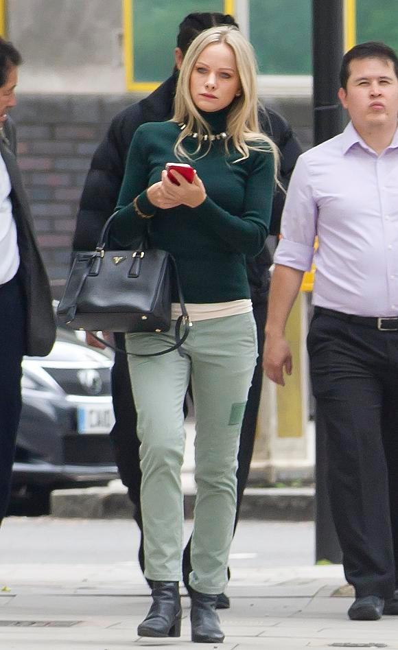 The Polish student wore green as she arrived at Westminster Magistrates' Court today
