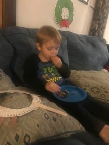 Alex eating chocolate cookies