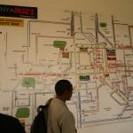 "Drummond Pike and ACORN Kenya organizers looking at the ""matatu"" bus map on the iHub wall"