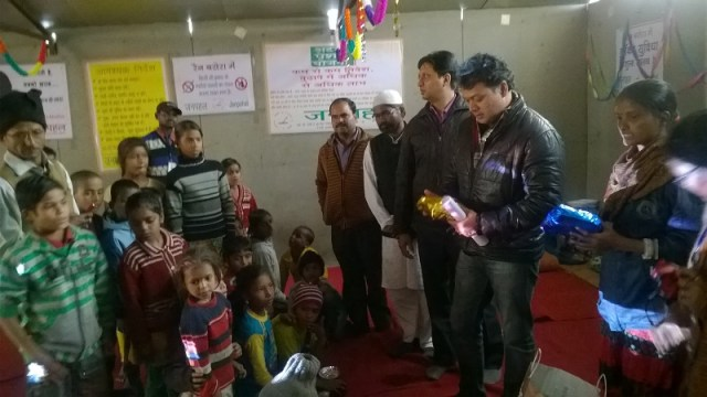 Local Legislator playing santa and distributing gifts to homeless kids on christmas
