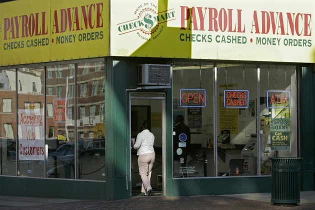 A customer enters a Payroll Advance location in Cincinnati. (Al Behrman / AP)