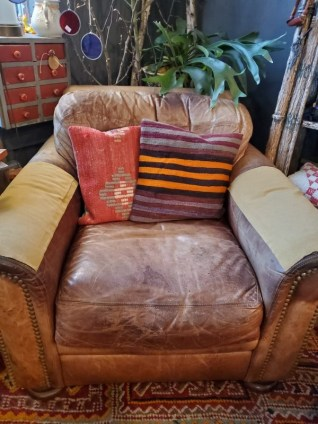 leather chair with hand made pillows