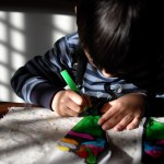 Boy learning to draw