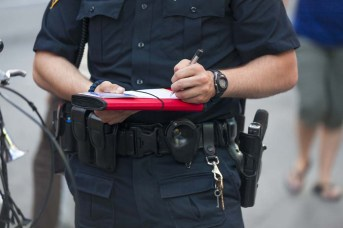 Police officer writing on a piece of paper