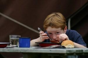 938237_20495420 boy eating soup