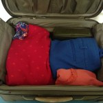 Packing children's suitcases for the trip ahead