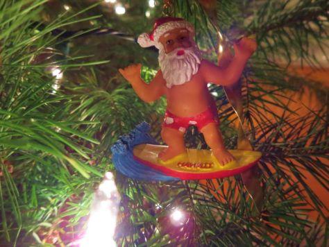 Hawaiian surfing Santa Claus ornament