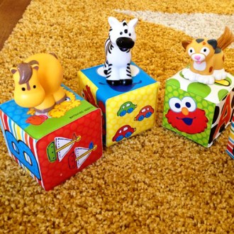 Games for Babies  5 Ways to Play with Soft Blocks   Childhood101 baby games to play with blocks