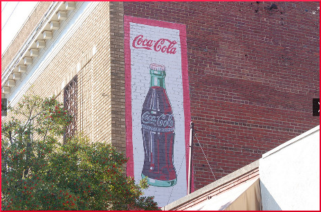 Coca-Cola ad on side of wall