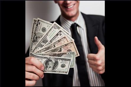 man holding wad of bills