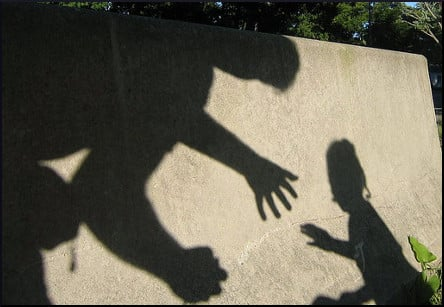 [ominous shadows of a man and a child]