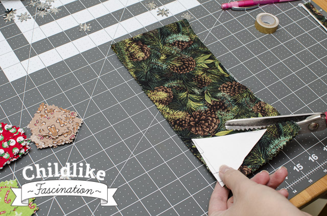 Cut out triangles of the green pine fabric