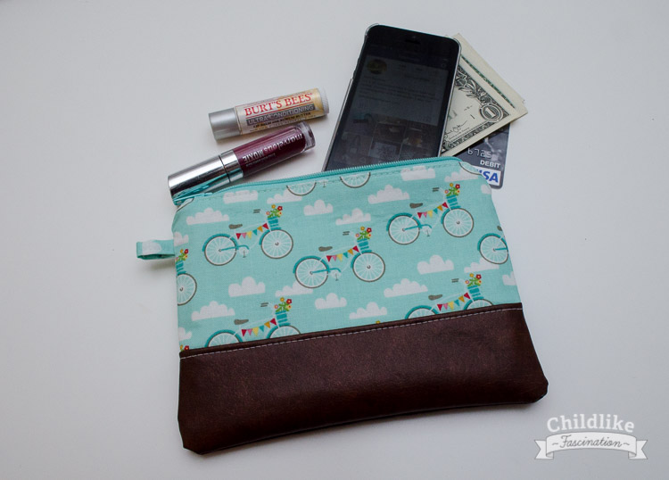 Little clutch holds cell phone, lip gloss and money no problem!