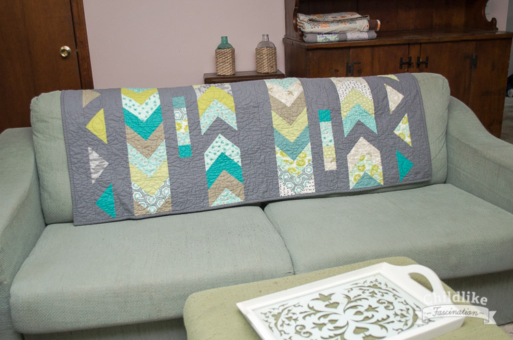 Goose Lane quilt over the back of my couch