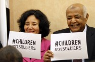 Leila Zerrougui and Yemen's Prime Minister Mohamed Salem Basundwah hold Children, not Soldiers signs at the ceremony for the signature of the action plan.  Copyrights: @UNICEF