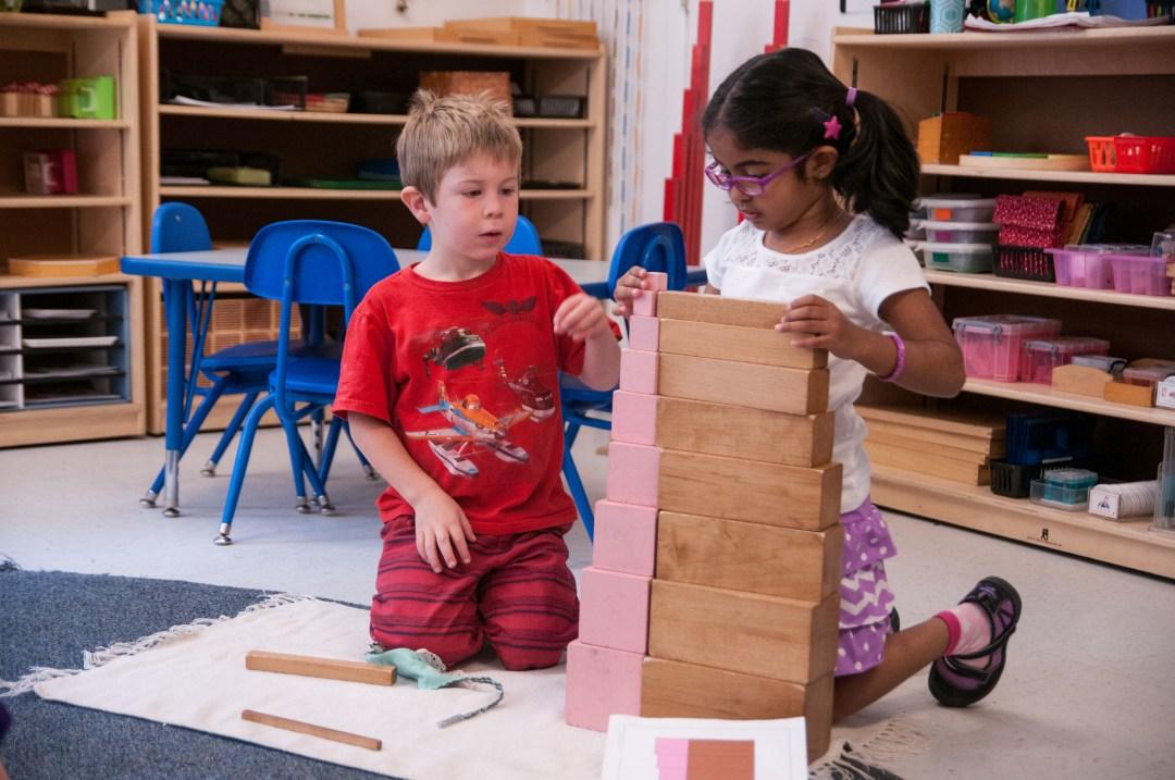 Two children using Sensorial materials at Children's House Montessori School in Reston, Virginia
