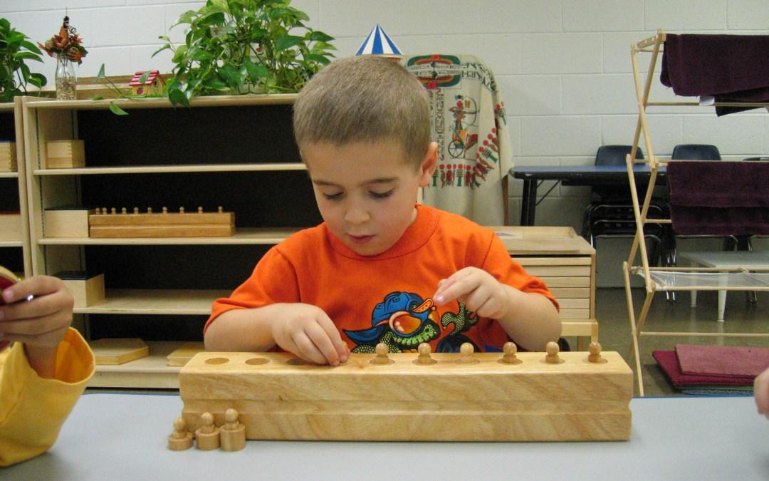 Child using Montessori materials Blog post 4 Important Lessons Kids Learn in Montessori