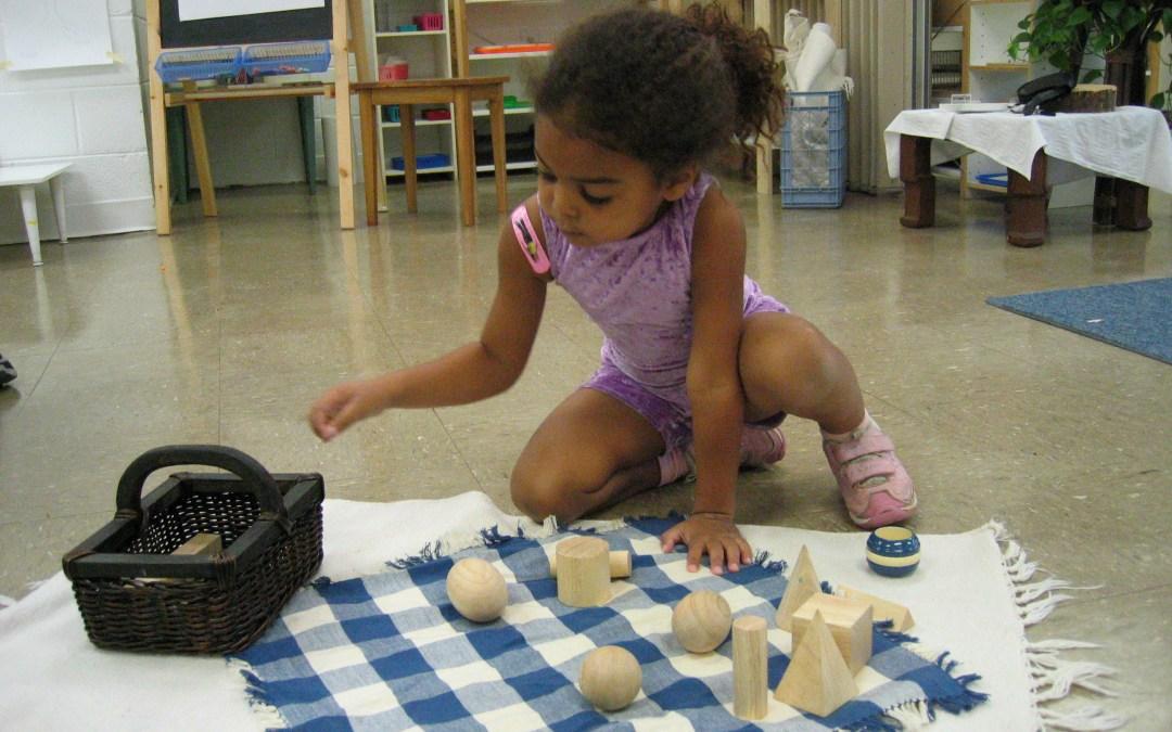 Child using Montessori Sensorial materials.