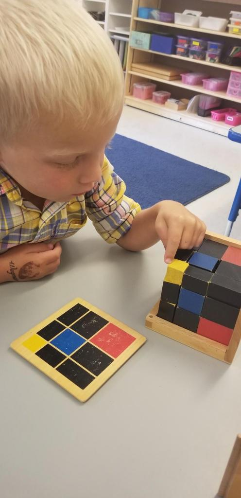 student concentrating at Children's House Montessori School of Reston
