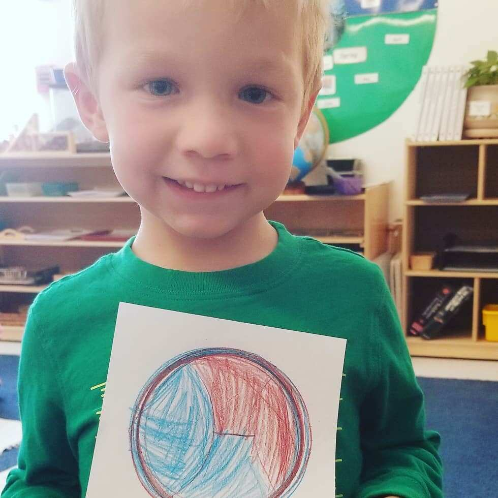 boy with drawing / character development in early childhood