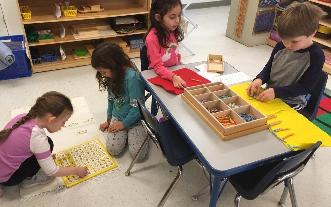 Montessori kindergarten students working at Children's House Montessori School of Reston