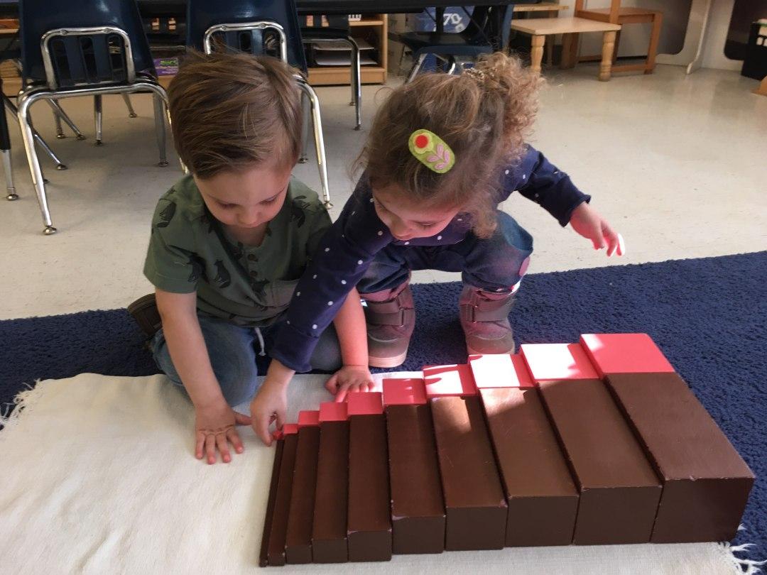 Two children working together. Creativity in the Montessori classroom. Children's House Montessori School of Reston