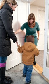 Karen A Francioso-Howe welcoming a child into her office