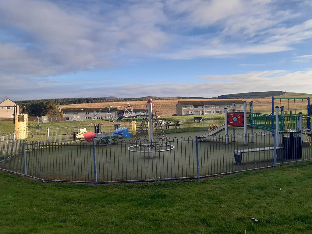 View of a children's play park with blue skies in the background