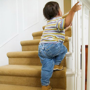Toddler climbs the stairs