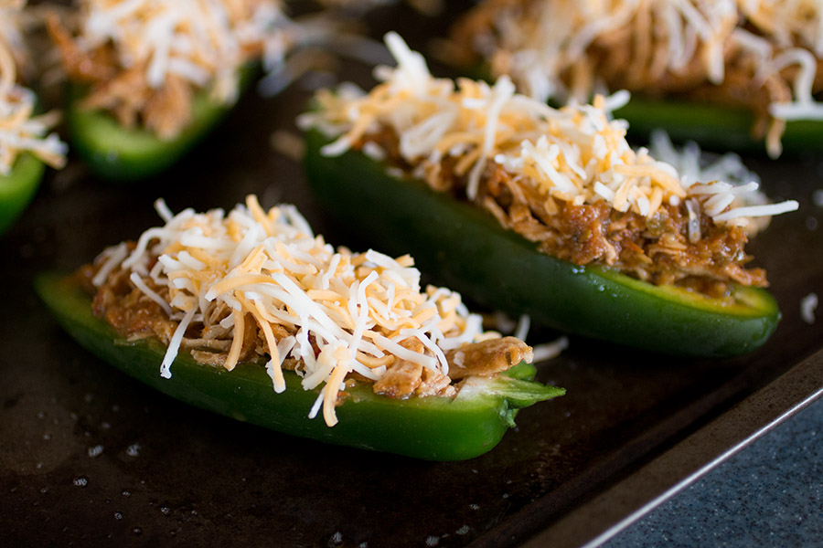 Top your jalapeno poppers with cheese.