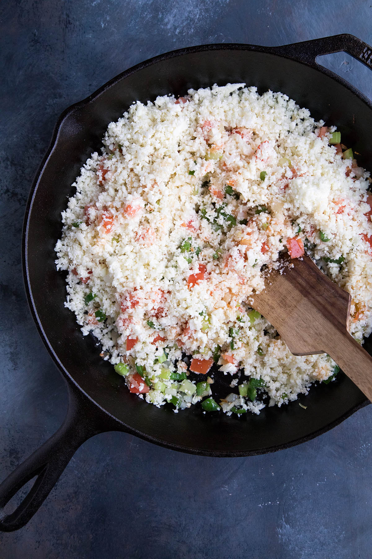 Making Cajun Cauliflower Rice - Stir in the Riced Cauliflower