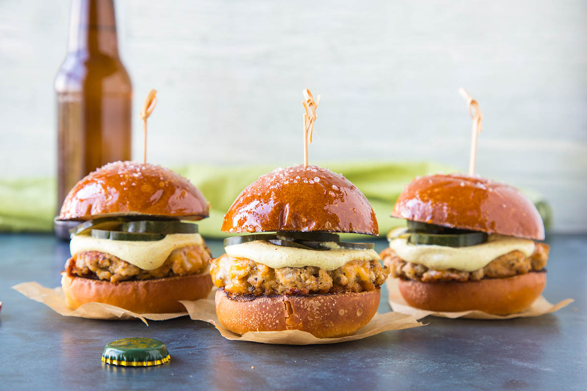Ground Pork Sliders with Mustard Cream and Quick Pickled Cucumbers – Recipe