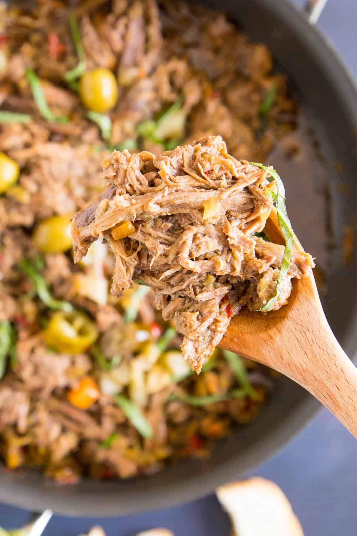 Feisty Italian Slow Cooker Pot Roast - Fork tender beef roast ready for your next meal.