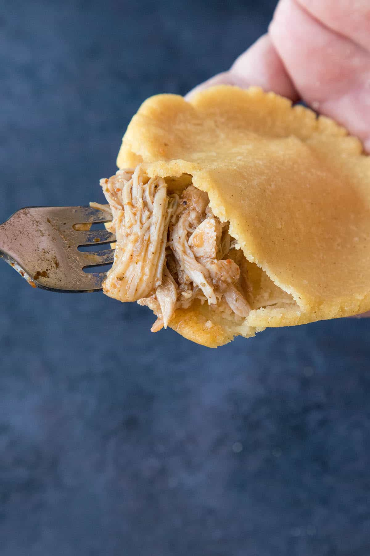 Stuffing a Mexican Gordita with delicious pulled chicken