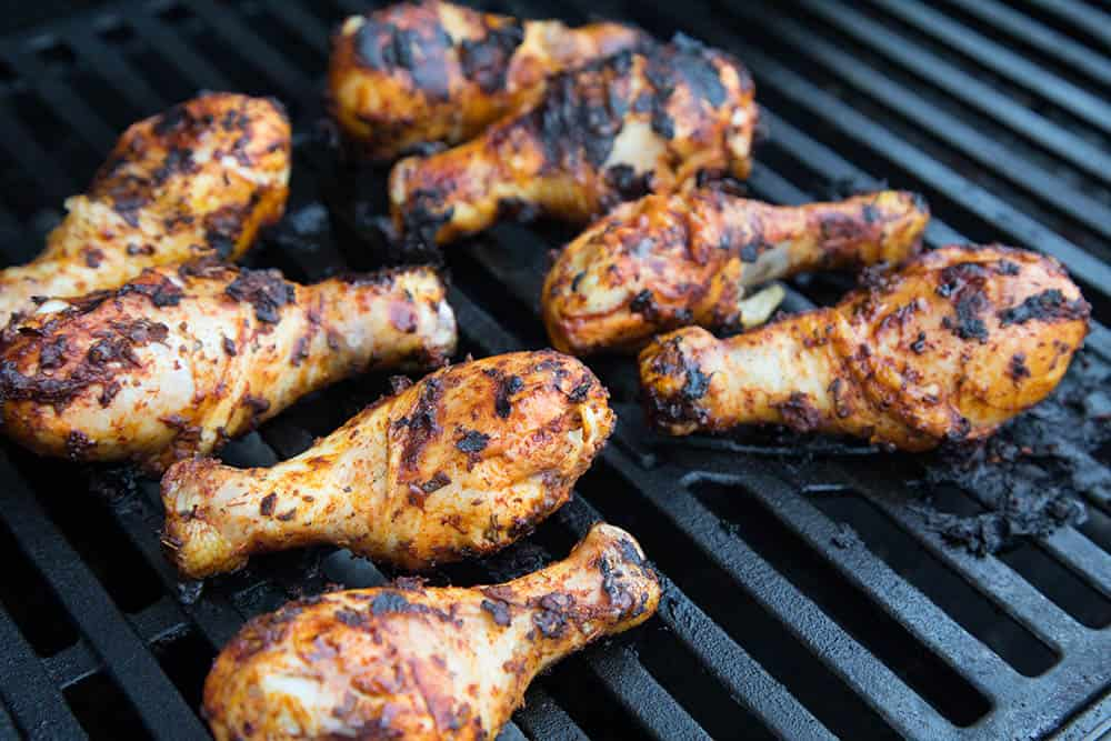 Grilled Harissa Chicken Legs On the Grill, Cooking, Nicely Charred