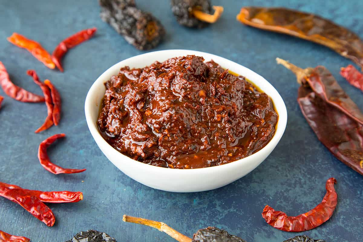 Homemade Harissa in a while bowl - made from dried peppers, toasted herbs and spices